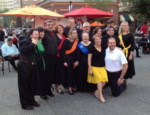 """Chris Roth, Becky Stern and the Special Needs Ballroom Exhibition Team pose for a picture after performing at """"Dancing in the Square"""" in 2013."""