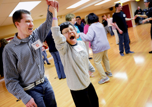 """Julia Rendleman/Post-Gazette. 11/22/2015. Tracey Dzurenda, 30, of Baldwin and her dance mentor Brian Fox of North Versailles laugh as they practice their spins during the special needs ballroom dance class Sunday, Nov. 22. """"I like the people here and I love Chris,"""" Ms. Dzurenda said of her instructor. Section: Local"""